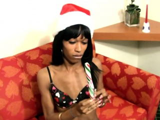 Black t-girl inserts xmas toy deep inside her butt hole