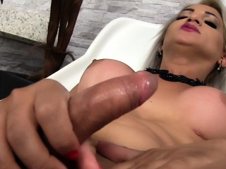 Busty trans masturbates her cock solo