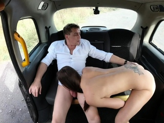 Hot brunette undressed in a taxi