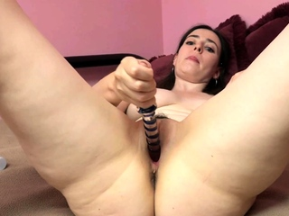 Chloe Faye is being playful with her glass dildo