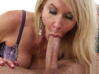 Busty mature slut sucks on young cock