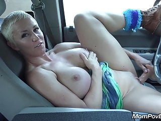 Big tit MILF masturbates in car